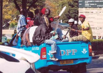 DPP youths brandishing pangas a day before the July 20 2012 demonstrations
