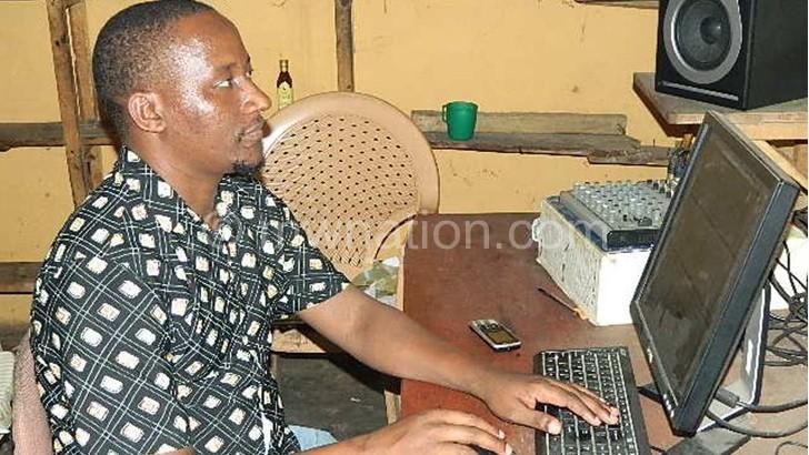 Mtokoma edits one of the Catholic choir group's collection