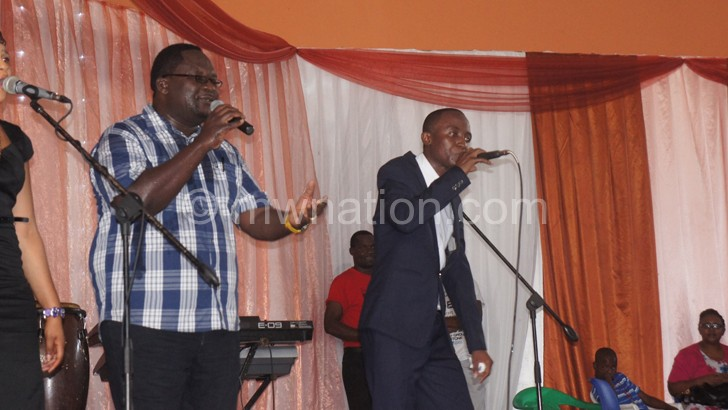 Lucius (L) shares the stage with Thoko Katimba during the latter's album launch at Robin's Park