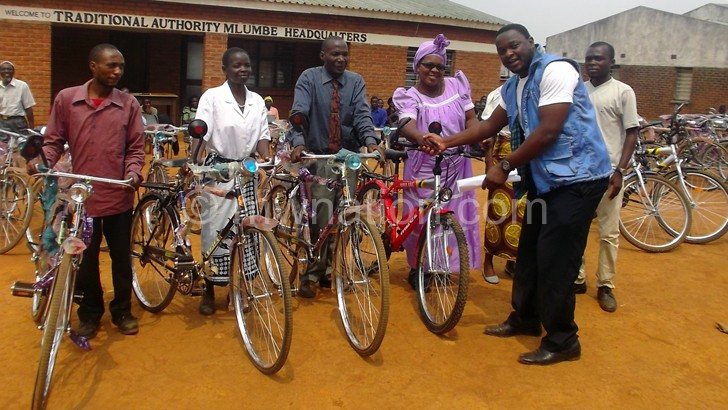 Mwandira handing over bicycles to community educators