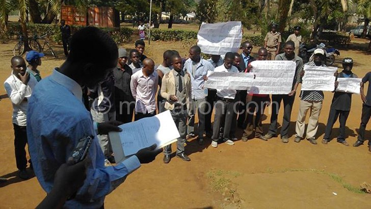 Teachers presenting a petition to Mulanje DC
