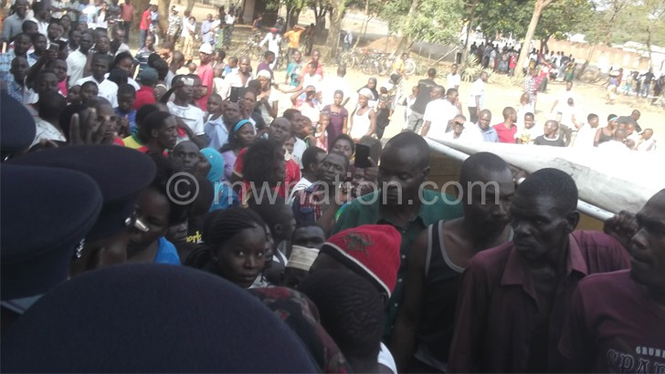 Concerned citizens block the entrance to the Karonga Magistrate's Court