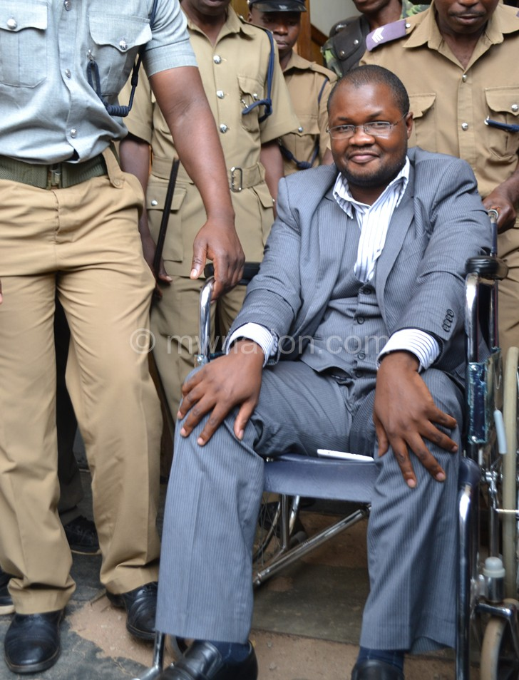 In one of his many court appearences before the conviction: Lutepo (seated on the wheelchair)