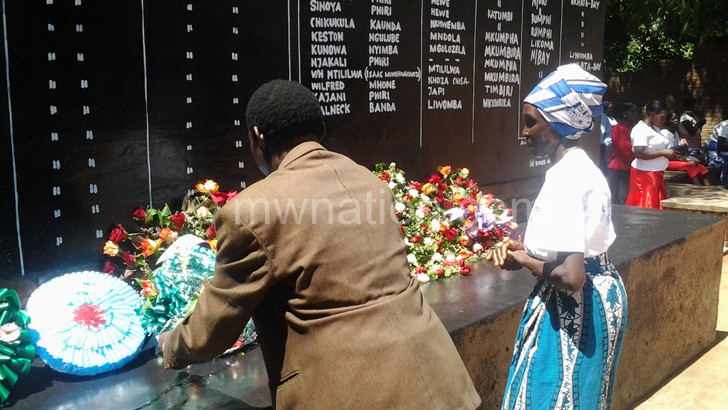 Relatives lay wreaths at the 1959 Martyrs memorial tombstone in Nkhata Bay