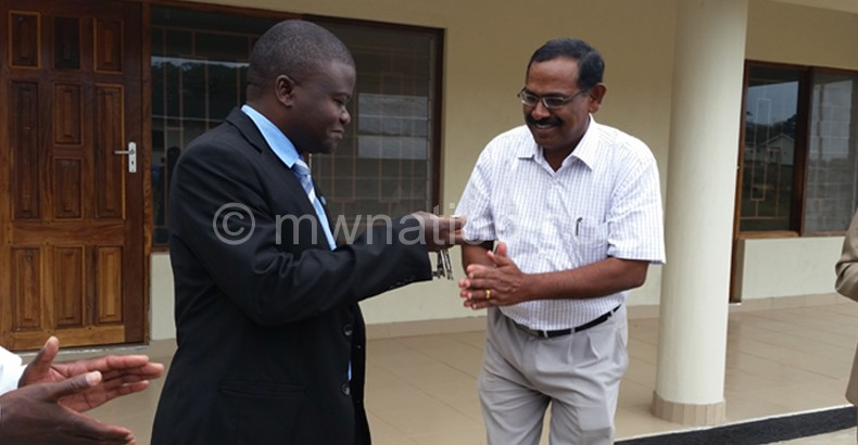 Here you are: Pillai (R) hands over keys to Kampalume