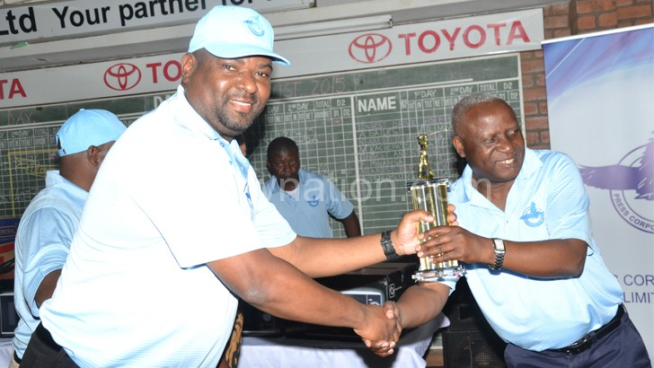 Nthakomwa (left) receiving a trophy from PCL board chairperson Simon Itaye