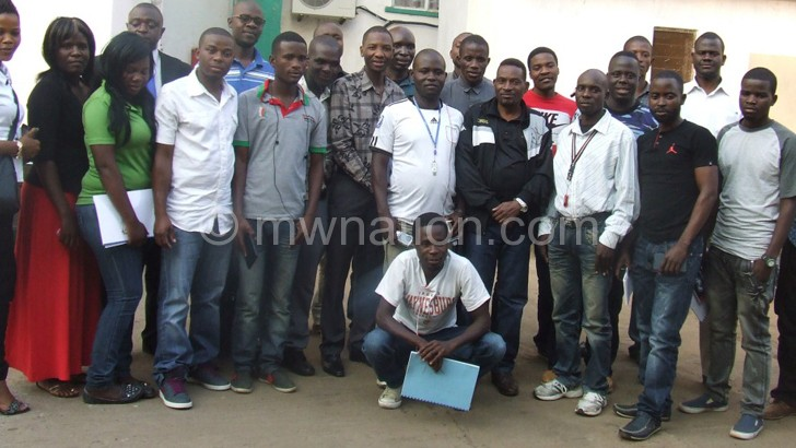 Swam members pose for a group photograph after the workshop