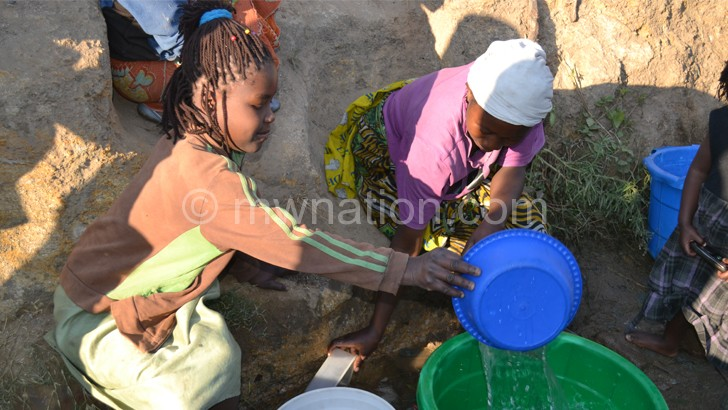 Women in Nsanje walk long distances to find safe drinking water