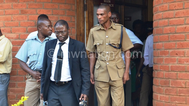 Kasambara walks out of the court in Lilongwe
