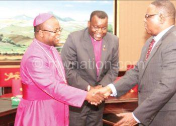 Mutharika greets Bishop Malasa as his aide on religious affairs  Apostle Timothy Khoviwa looks on