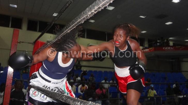 Mtimaukanena (R) defeated Kenyan and Tanzanian boxers