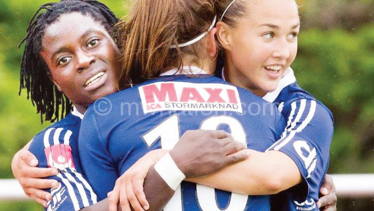 Chawinga (L) celebrates her moment of glory with teammates