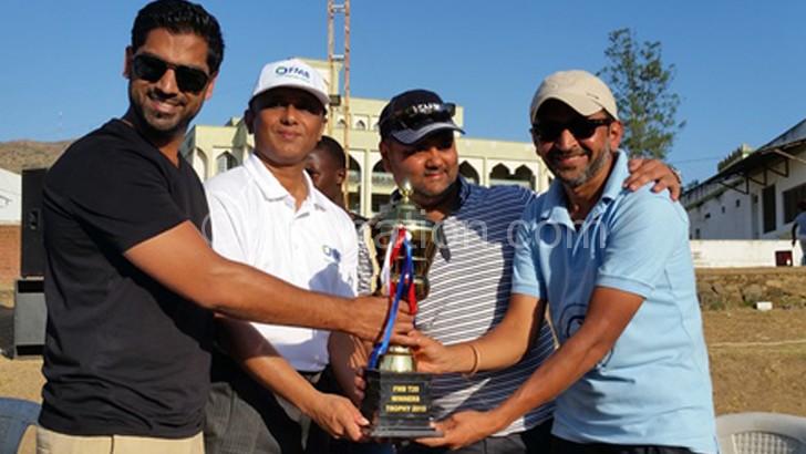 Limdawala (R) receives the trophy from Kadantot (2ndL) as Jagot (2ndR) and Anchor Industries' Tarik Kidy look on