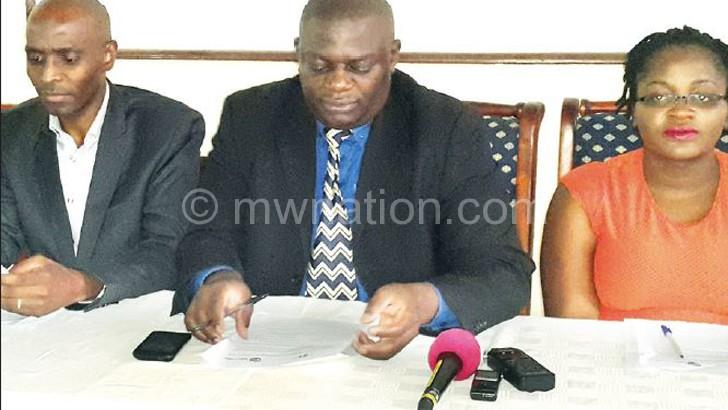 Mkwezalamba (C) with other activists addressing the media
