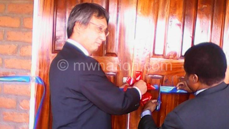 Alufandika and Nishioka cutting the tape at the handover ceremony