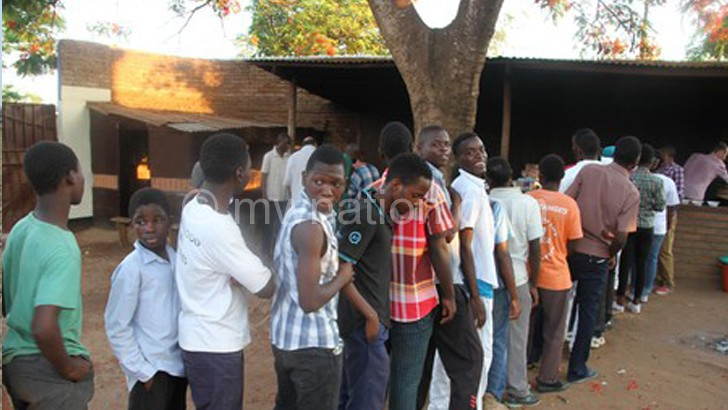 Youths queue to have their share