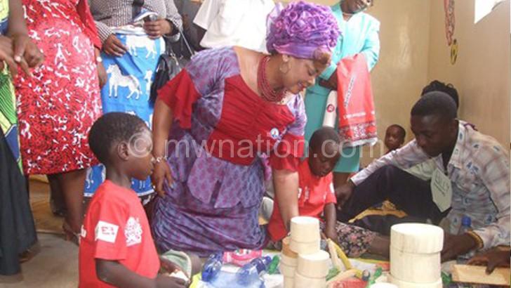 Kaliati admiring some work by learners at Chikwawa CBCC in Rumphi
