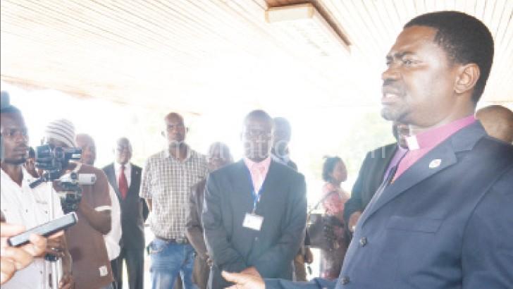Kambalazaza speaks to reporters at Chileka Airport
