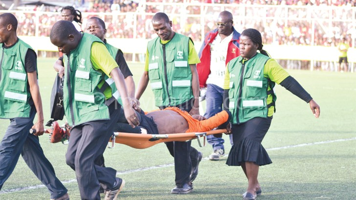 Big Bullets goalkeeper Owen Chaima is carried off the pitch after suffering an injury