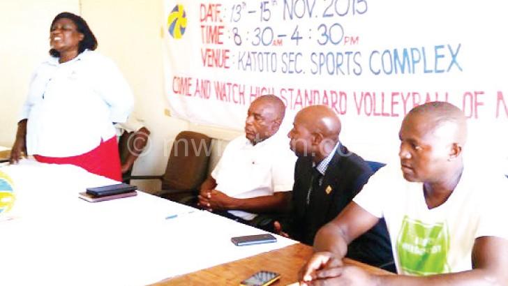 Msowoya (standing) and VAM officials Nkhoma (2ndR), Kaunda (R) during the press briefing