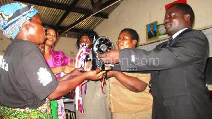 A symbolic presentation of sewing machines to community members