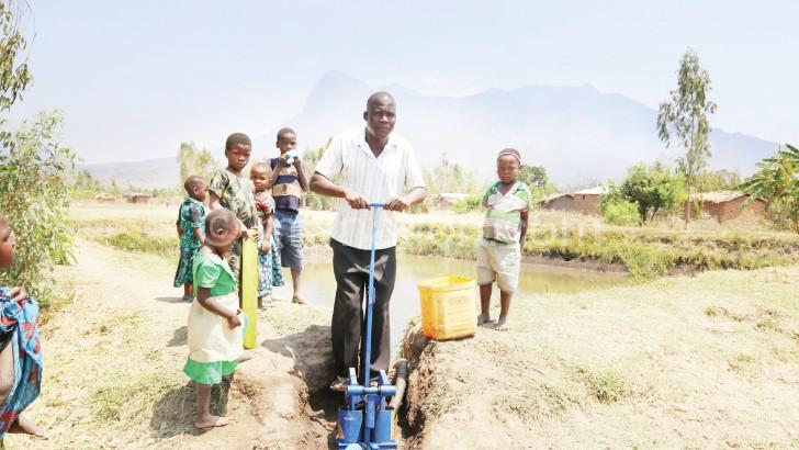 Bisani uses a treadlepump to irrigate his garden