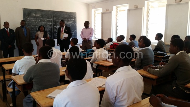 Officials inspecting desks at Soche Hill Secondary School in Blantyre