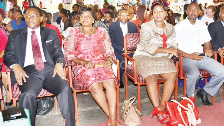 (L-R))MCP president Lazarus Chakwera and wife alongside son Nick and his wife Rudo attend a  Christmas service at IC Marquee in Lilongwe