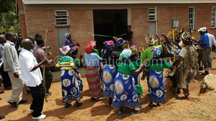 Locals dancing at the handover ceremony