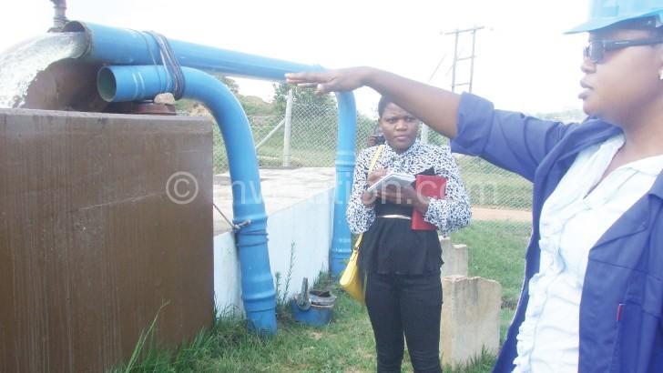NRWB engineer Cathy  Mwafulirwa (R) explaining how the Lunyangwa water  treatment point works