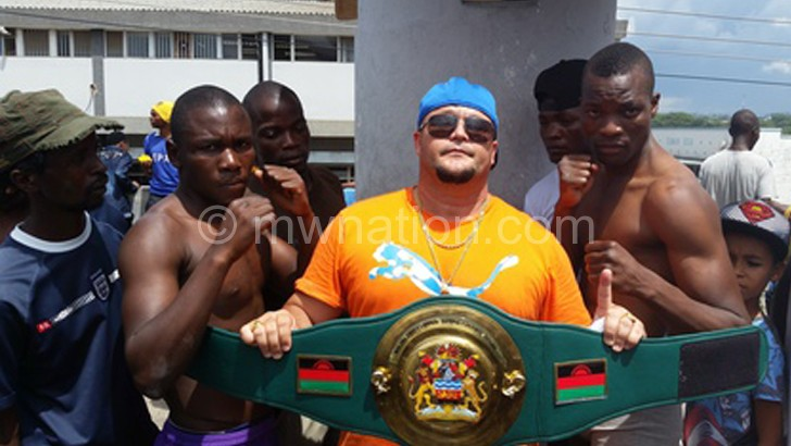 Rousseau poses with the boxers after wiegh-in