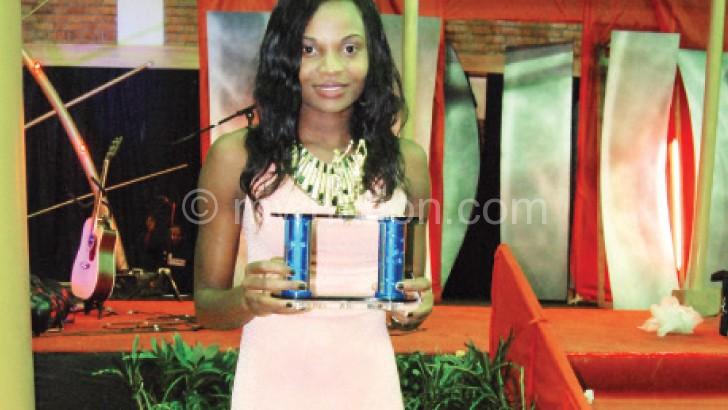 Kumwenda poses with her trophy