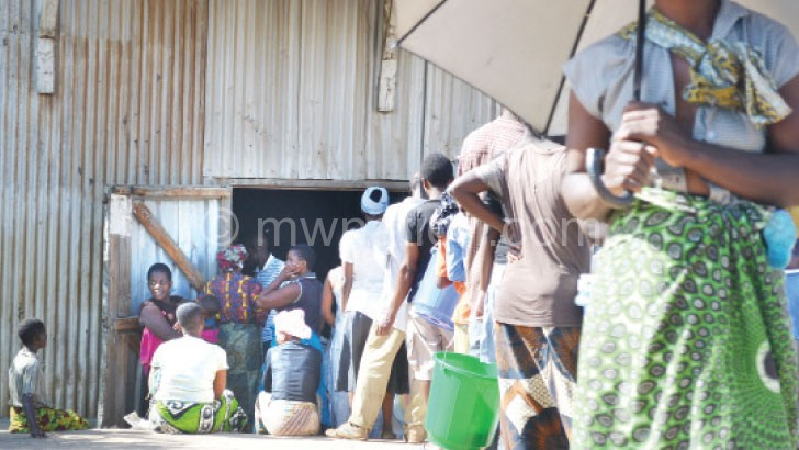 People queuing for the scarce maize at Zingwangwa Admarc selling point in Blantyre