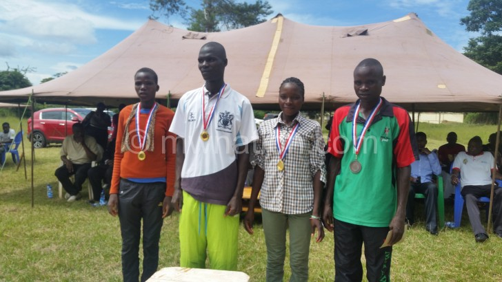 The winners show off their medals