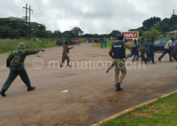 Police and army instructing protesters to clear the M1 Road
