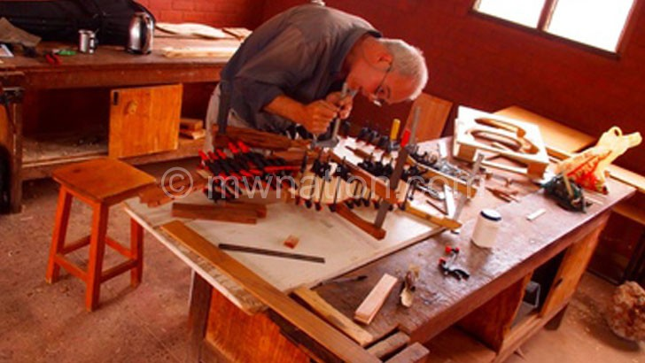 Vanhoutte at work making a guitar in his workshop