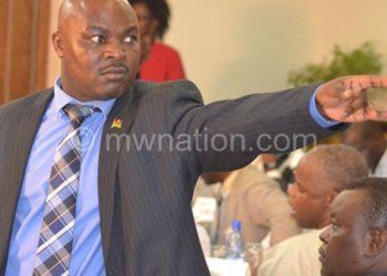 Information Minister Jappie Mhango telling Msonda to shut up and sit down