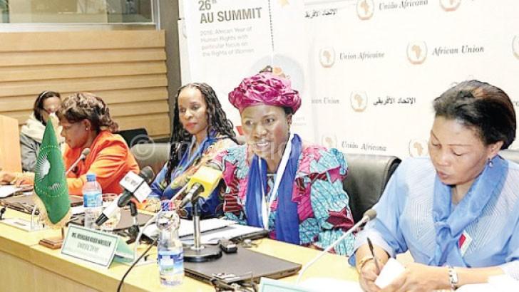 Kaba (centre) speaks at the summit