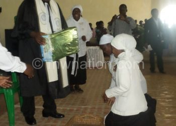 Zingani receives a present from  the women's guild
