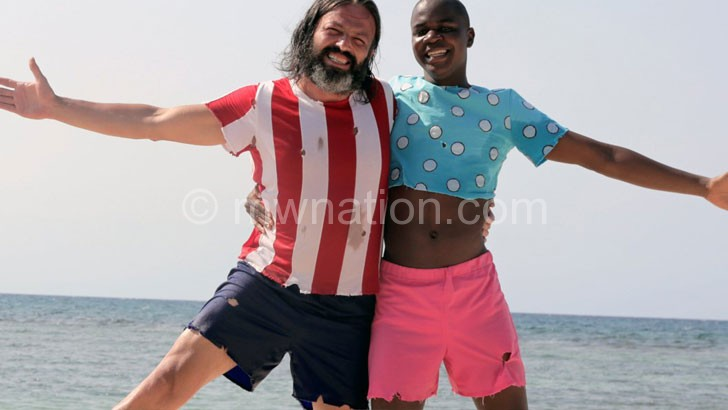 Nyambi (R) starring with Serhat Kılıç in a scene from Robinson Crusoe and Friday