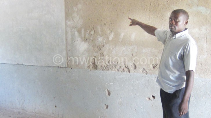 A community member pointing where a chalkboard was