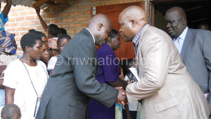 Mwaluka (2ndR) congratulates Ndalama