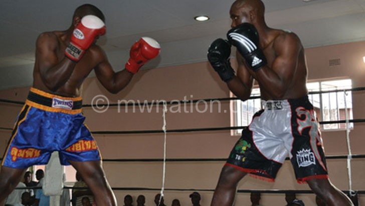 Red gloves with white knuckle area won by boxer on the left are meant for amateur boxing