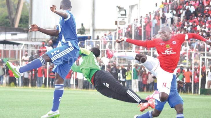 Top drawer: Dynamos goalkeeper Mateyaunga denies Chiukepo Msowoya (R) with an incredible save
