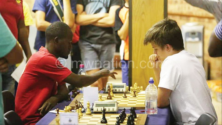 Chipanga (L) taking on South African opponent