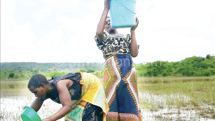 Potable water is a scarce commodity for many Malawians, forcing some to share water sources with animals