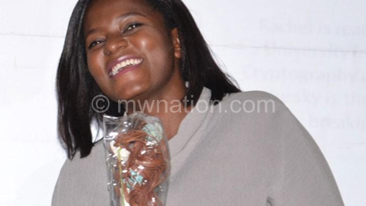 Chabvuta shows off her award