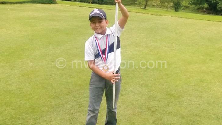 Mussa celebrates his triumph on the final hole