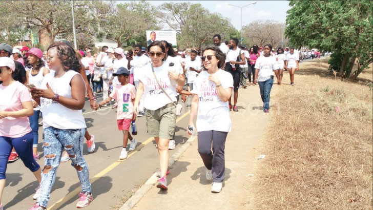 Raising breast cancer awareness: A cross section of people take  part in a Pink Think march