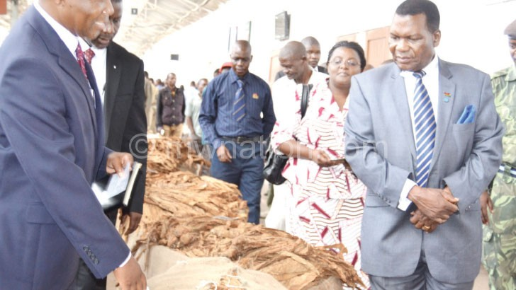 Flashback: Chaponda (R) inspecting tobacco bales at Limbe Floors